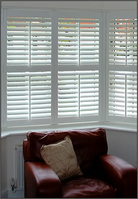 Image Of Full height Shutters On A Bay Window