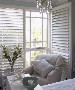 Image of white plantation shutters on a window